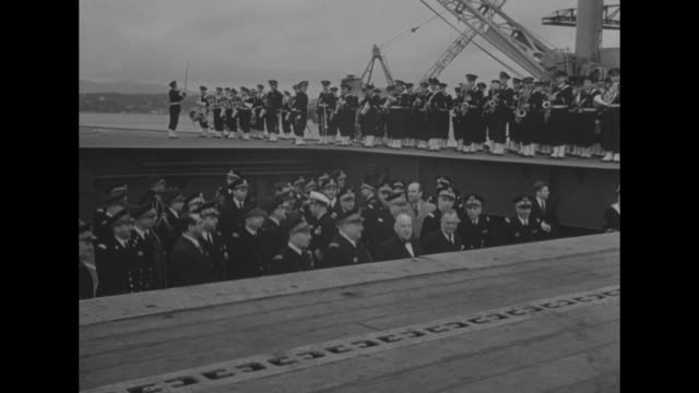 ñoff to indo china: us carrier lent to frenchî superimposed over shipyard / ñbois belleauî painted side of aircraft carrier ship / lift rising to... - matros bildbanksvideor och videomaterial från bakom kulisserna