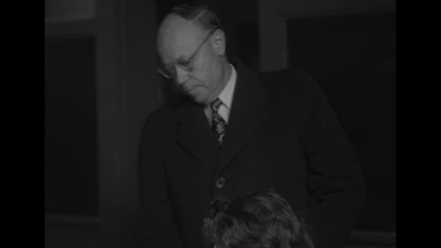 ohio superimposed over ms of senator robert taft exiting car / mcu taft / ms taft marking ballot woman seated next to him in foreground / ms taft... - card table stock videos and b-roll footage