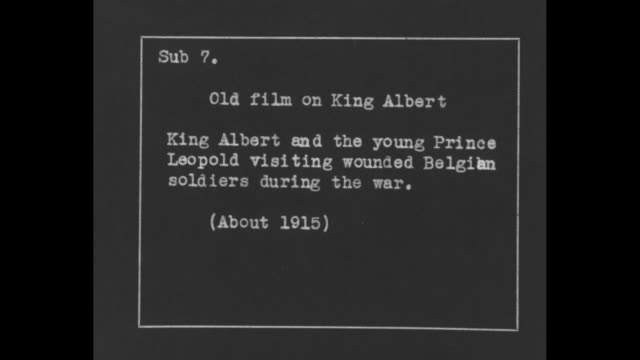 """""""old film on king albert: king albert and young prince leopold visiting wounded belgian soldiers during the war """" / albert in army uniform leans over... - lying on side stock videos & royalty-free footage"""