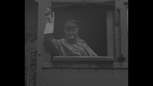 Oldest Engineer at Throttle 75 YearsMilwaukee WisJohn Horan celebrates diamond jubilee in railroad service / locomotive comes to stop people on...