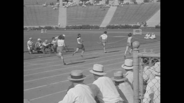 olympic champions in action records fall on field and track as star athletes show their speed / crowd in stands at 1932 summer olympics at los... - star jump stock videos & royalty-free footage