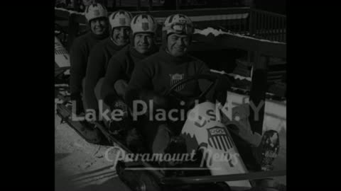"""""""olympic winter games near"""" / title: """"lake placid, n.y."""" superimposed over american bobsled team in their sled / vs final test run of bobsled team... - bobsledding stock videos & royalty-free footage"""