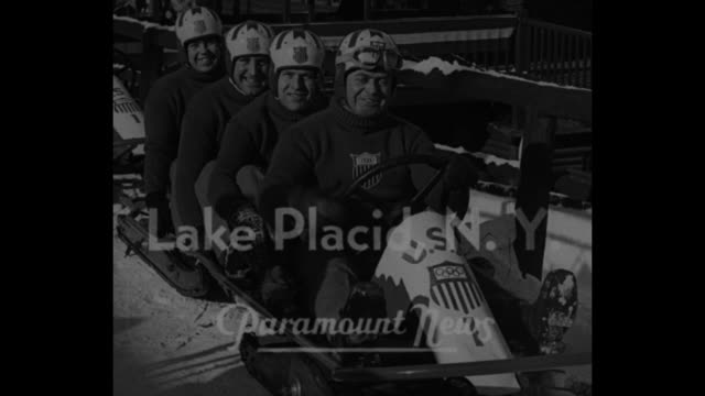 olympic winter games near / title lake placid ny superimposed over cu of american bobsled team in their sled / vs final test run of bobsled team... - bobsleighing stock videos & royalty-free footage