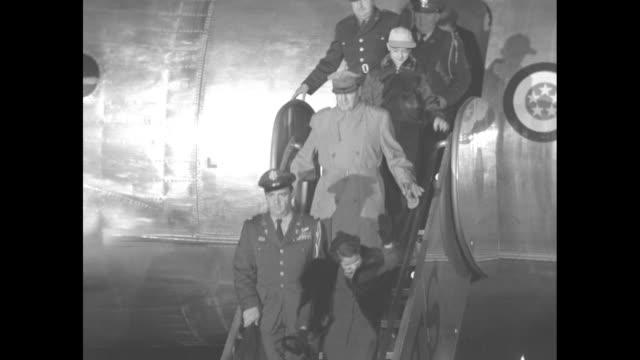 vídeos de stock, filmes e b-roll de on to washington to address congress superimposed over crowd at airport / cu of macarthur's military plane bataan / general douglas macarthur wife... - general macarthur