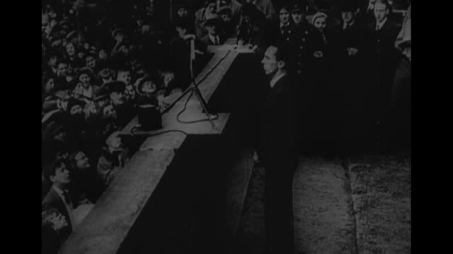 opening of the official antisemitic campaign 1 april 1933 / world war ii / joseph goebbels on balcony with large crowd giving nazi salute / ls large... - judaism stock-videos und b-roll-filmmaterial