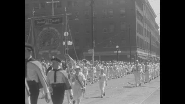 orangemen in parade ten thousand march in great celebration at toronto / boys with berets and cockades with a large banner following / a large crowd... - passing a note stock videos & royalty-free footage