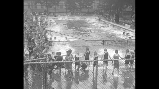 orphans have hot time cooling offphiladelphia paboys at st john's orphanage enjoy plunge as thermometer rises / boys in swimsuits crowded around... - orphan stock videos & royalty-free footage