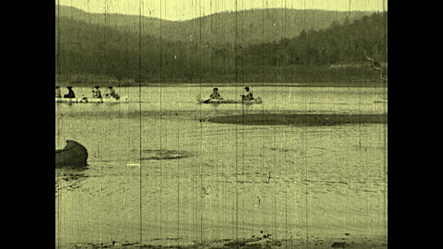 """""""out of canada, with the opening of spring, came the french reply to virginia's challenge""""; french soldiers rowing canoes across the lake. historical... - kayak stock videos & royalty-free footage"""