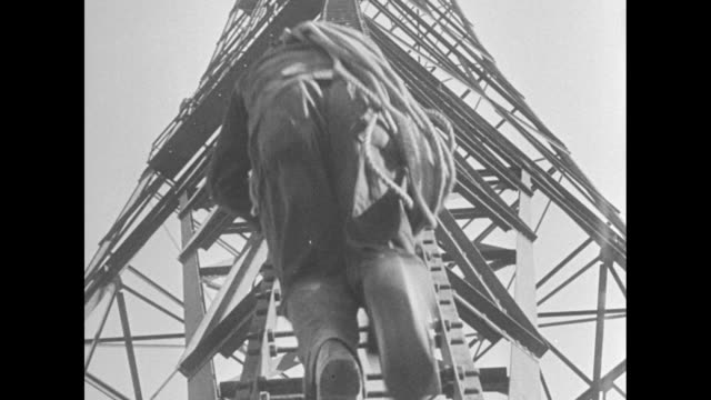"""""""outside, workmen hang in midair to repair tower"""" / line of radio towers leading up to plant / shot from above of workmen climbing up ladder on tower... - rca stock videos & royalty-free footage"""