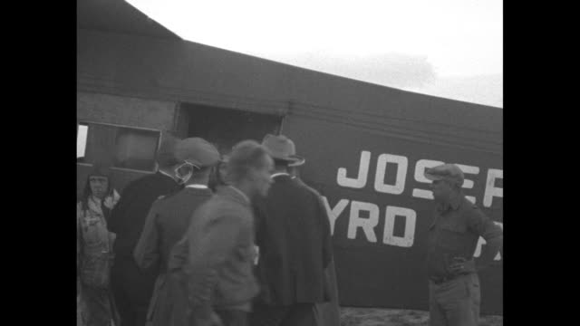 Over the Rockies Famous Byrd polar plane flies over Rockies Gov Morley of Colorado greets Pilot Floyd Bennett on arrival of Josephine Ford at Denver...