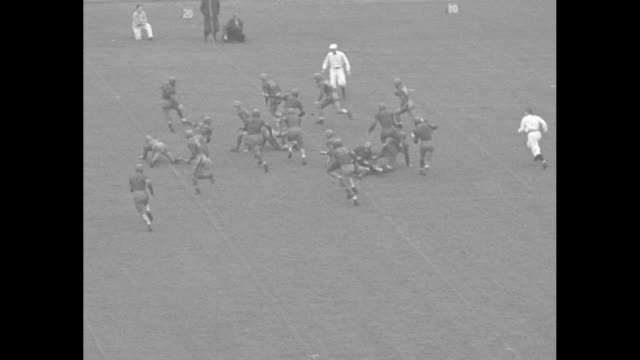 panthers claw up w and j / kickoff during football game between pittsburgh panthers and washington jefferson presidents / runner goes for 13 tackled... - 1934 stock videos & royalty-free footage