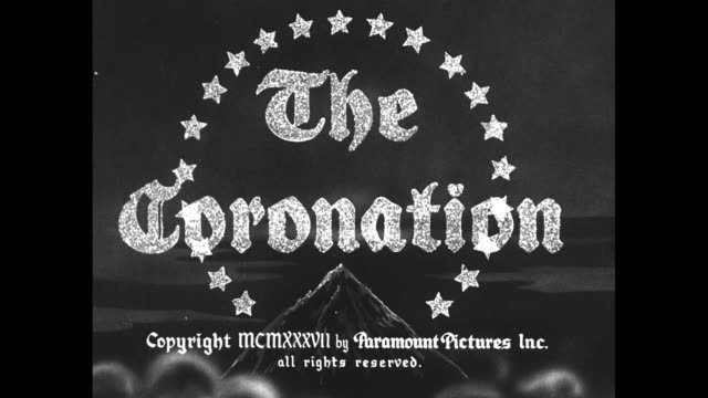 paramount news / title card presents / title card the coronation / ws ext buckingham palace and environs / eight horses pull the gold state coach out... - coronation stock videos & royalty-free footage