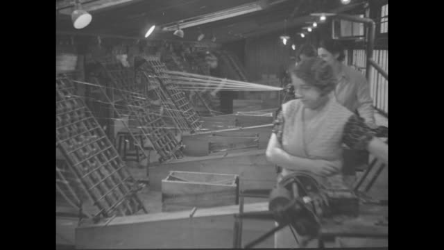 paris adopts summer furs of cellophane / title paris superimposed on women at textile looms / vs fibers roll to several spools woman at roller /... - cellophane stock videos and b-roll footage