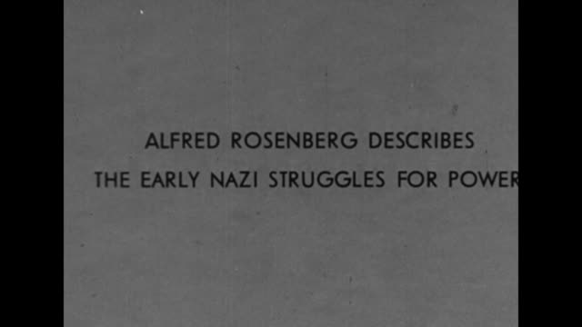"vídeos y material grabado en eventos de stock de the rise of the nsdap 1921-1933"" / title card: ""alfred rosenberg describes the early nazi struggles for power"" / nazi flag flutters in wind / adolf... - fascismo"