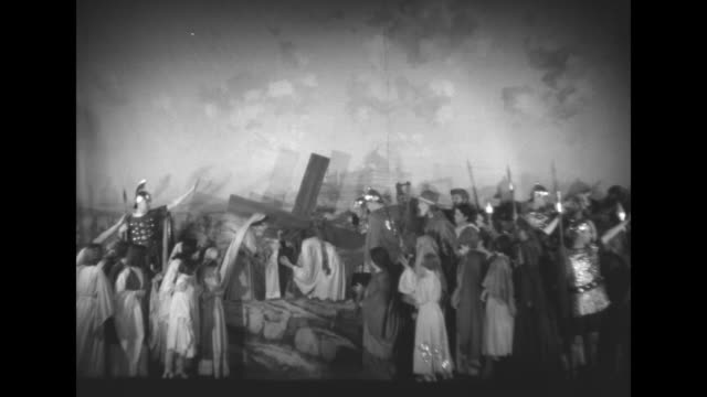 """""""passion play scenes portrayed by st joseph's r. c. church of union city, nj"""" / jesus christ character being led away by roman soldiers / christ... - religious cross stock videos & royalty-free footage"""