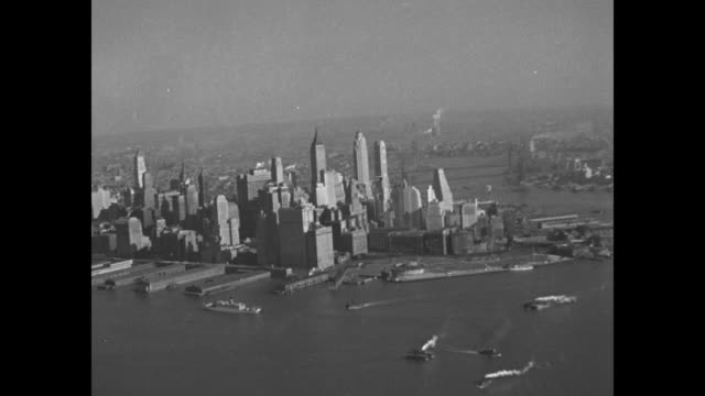 pathe news films new york from plane 4 miles up first motion picture of city are made at height of 20000 feet from army ship in daring altitude... - statue of liberty new york city stock videos & royalty-free footage
