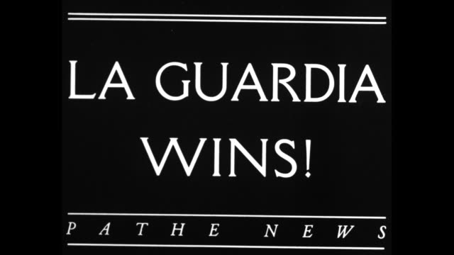pathe news special / title card la guardia wins / two close shots of nowmayor fiorello la guardia sitting at desk speaking to camera during his... - fiorello la guardia stock videos & royalty-free footage
