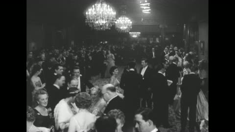 """""""pathe news"""" / title card: """"royal film performance"""" superimposed over attendees / high angle of many people in formal attire / unid couple / former... - premiere stock videos & royalty-free footage"""