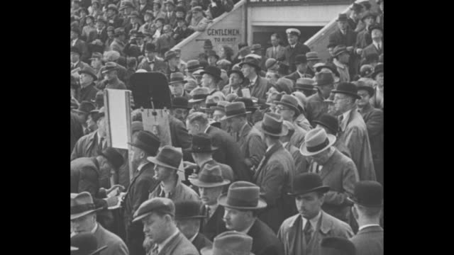 pathe presents / title the derby 1934 superimposed over two overhead shots of crowd at epsom downs racecourse / two overhead shots of crowd at... - gambling stock videos & royalty-free footage