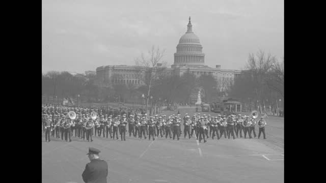 """""""peace parade"""" over black then superimposed over the us capitol dome / pan down capitol to marching band playing music and marching down street /... - wwi tank stock videos & royalty-free footage"""