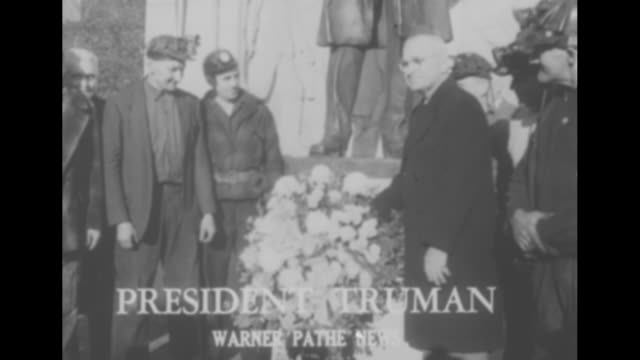 people in the news / pres harry truman places wreath at base of statue of labor leader john mitchell founder of united mine workers in scranton /... - hands behind back stock videos and b-roll footage