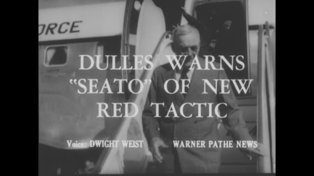 'people in the news' superimposed over people on an escalator / title card' dulles warns 'seato' of new red tactic' superimposed of dulles... - virginia us state stock videos and b-roll footage
