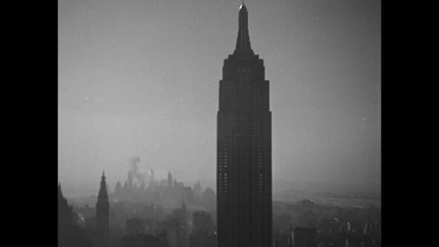 """""""pictures through the air"""" superimposed over city skyline / new york city skyline / empire state building in foggy weather / note: exact year not... - rca stock videos & royalty-free footage"""