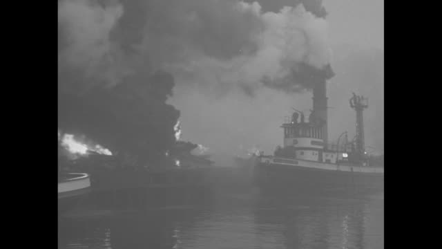 """pier fire!"" / vs fireboats spray water on fire, lots of black smoke / firefighters on boat spray water / fireboat sprays water, lots of black smoke... - burning stock videos & royalty-free footage"