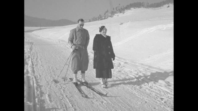 'Playtime Now Lures Europe's First Families' / title 'Tatra Mountains' superimposed over Princess Juliana and Prince Bernhard on their honeymoon in...