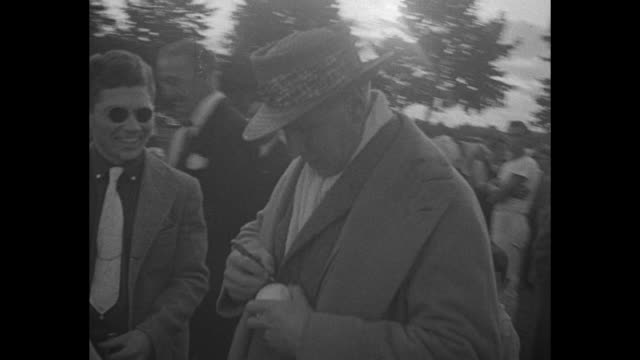 polo / spectators in stands / tommy hitchcock jr in fedora autographs ball / cu of jock whitney in flat cap / polo player riding on horseback / four... - flat cap stock videos & royalty-free footage