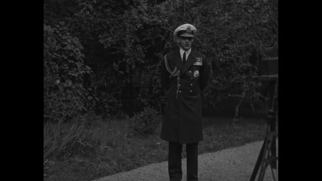 'Prince Nicholas who helped brother in return to throne becomes new ruler's chief aide' / WS Prince Nicholas of Romania stands outdoors wearing dark...