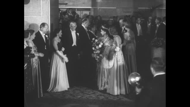 òprincess at film premiereó superimposed on view of elizabeth walking down reception line in lobby of theater / elizabeth walks along reception line... - princess stock videos & royalty-free footage