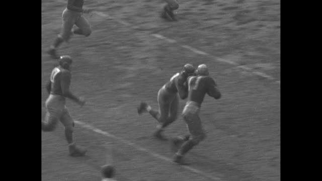 'Pro Stars Redskins scalp football Giants' / [NOTE Redskins and Giants are wearing very similar uniforms Redskins are in lighter colored leather...