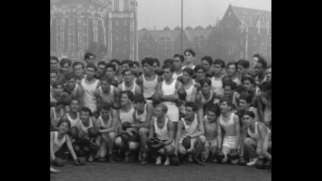 """vídeos de stock e filmes b-roll de """"professor of socko! new york - lessons with a punch! benny leonard, famous ex-lightweight champ, takes 'chair of boxing' at city college."""" /... - lightweight"""