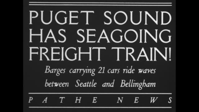 """""""puget sound has seagoing freight train! barges carrying 21 cars ride waves between seattle and bellingham"""" / barges with freight train cars through... - puget sound stock videos & royalty-free footage"""