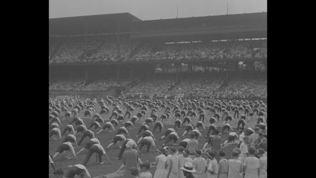 pupils stage great pageant pittsburgh thousand gather at forbes field to see school exhibition / vs large group of teen boys and girls exercise with... - human stage点の映像素材/bロール