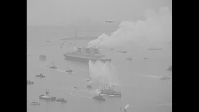 """""""queen of the seas"""" then superimposed over french ocean liner ss normandie / vs ss normandie with smoke coming from smokestacks / horn blows and... - spray stock videos & royalty-free footage"""