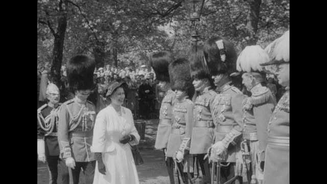 queen unveils memorial to her guardsmen superimposed over side shot of queen elizabeth ii shaking hands with prince henry and others / queen... - brigade stock videos and b-roll footage