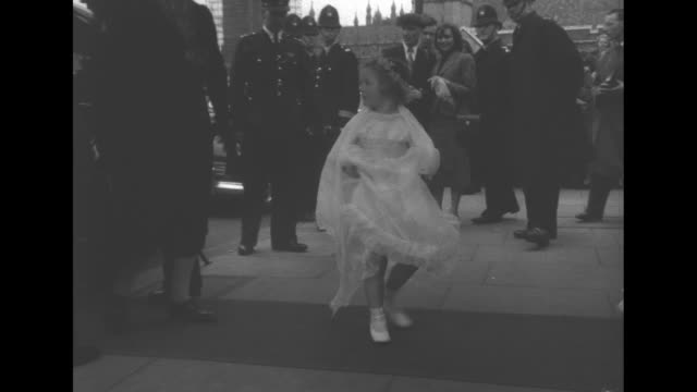 stockvideo's en b-roll-footage met queen's cousin weds superimposed over st margaret's church / pan down to crowd and covered walkway of the church / flower girl entering holding up... - prinses margaret windsor gravin van snowdon