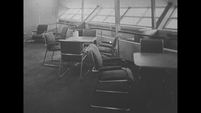 """""""queens of sea and sky""""/ vs marshal von hindenburg airship in hangar / propeller / vs men on ladders working on hindenburg / vs rubber landing wheel... - wohngebäude innenansicht stock-videos und b-roll-filmmaterial"""