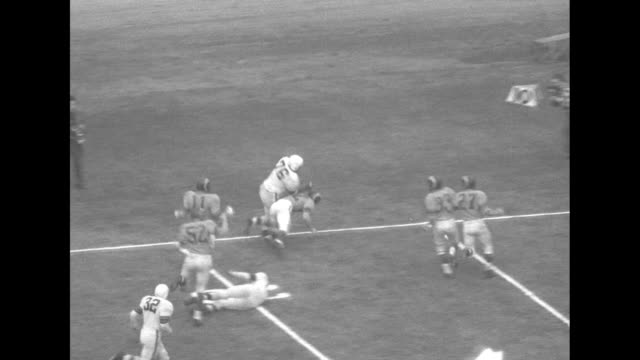 Rams Whip Browns for Pro Title superimposed over game / looking down on Browns' Lou Groza booting 52 yard field goal follow ball thru goal posts and...