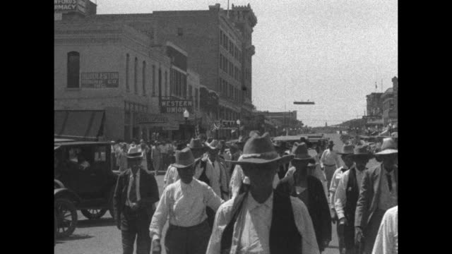 """""""ranger, texas - ex-rangers renew old ties where once they fought! frontier heroes who battled with indians in texas's early days parade in historic... - cowboy hat stock videos & royalty-free footage"""