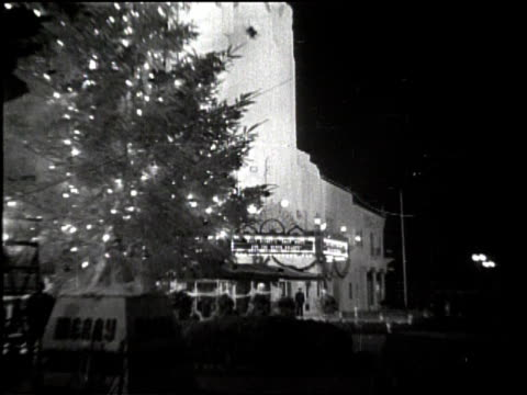 fantasy filmland thrills to snow white / carthay circle theatre spanish style architectural exterior of theater house at night with brightly lit... - 1937 stock-videos und b-roll-filmmaterial