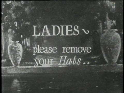 title card reads ladies, please remove your hats. - 無声映画点の映像素材/bロール