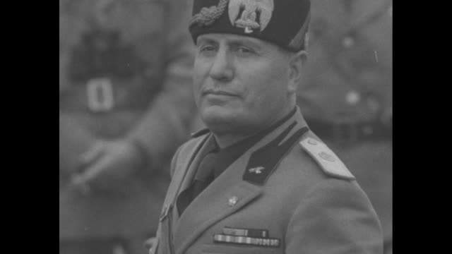rearmament italy / cu italian dictator benito mussolini in military uniform / italian soldiers moving in long column through desert landscape in... - benito mussolini bildbanksvideor och videomaterial från bakom kulisserna