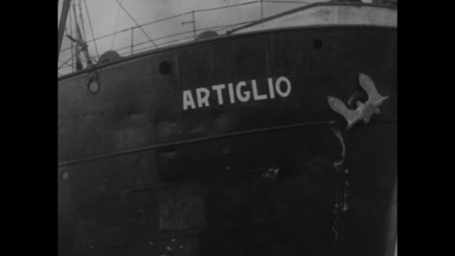 recupero da una antica nave / a man looks through a long spyglass with women mending a net in their boat / a recovery ship and a man in a smaller... - diving helmet stock videos and b-roll footage