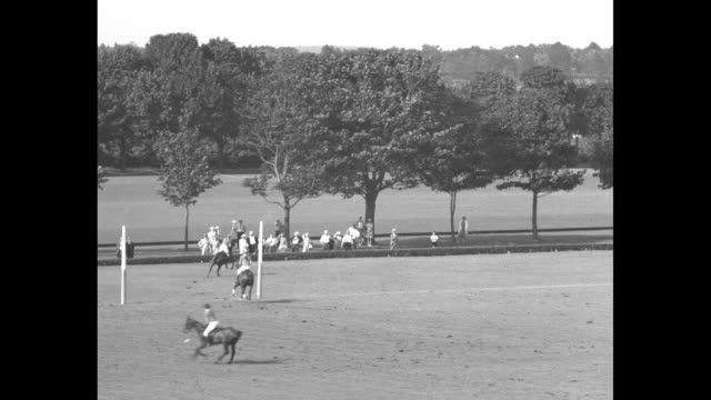 Red Cross topranking polo stars play benefit / VS of the polo chukka in play interspersed with welldressed people in the grandstands