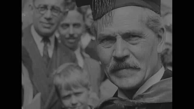"""requiem--ramsay macdonald finds peace at last"" / mcu british prime minister ramsay macdonald speaking / macdonald in group shot with one of his... - documentary footage stock videos & royalty-free footage"