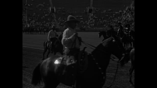 ride 'em cowboy oldtime rodeo with all the trimmings features big celebration of los angeles' 151st birthday / rodeo parade / crowd watching parade /... - bocksprång bildbanksvideor och videomaterial från bakom kulisserna