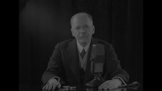 "pathe news"" with map / credits / new york city: commentator hans von kaltenborn seated at table talking of news about spanish civil war into... - spanish culture stock videos & royalty-free footage"